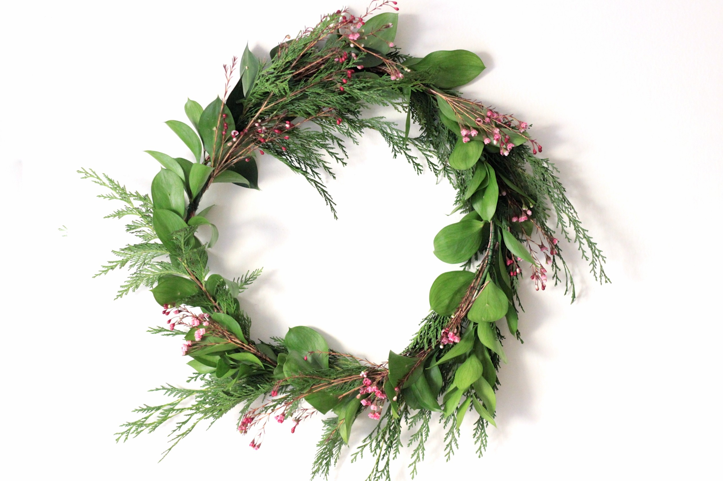 how to host a wreath making party adorned with love